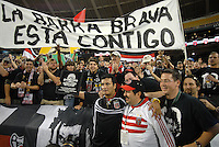 """DC United Marco Etcheverry is presented by fans from Barra Brava with a plaque honoring him, and in the back a banner that reads """"The Barra Brava is with you"""". DC United 1997 defeated United of Hollywood 2-1 in a game honoring former DC United forward Bolivian Marco Etcheverry at RFK Stadium in Washington DC, Saturday October 20, 2007."""