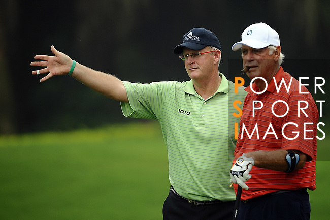 TAIPEI, TAIWAN - NOVEMBER 18:  John Jacobs (R) of England and Sandy Lyle of Scotland talk on the 16th tee during day one of the Fubon Senior Open at Miramar Golf & Country Club on November 18, 2011 in Taipei, Taiwan.  Photo by Victor Fraile / The Power of Sport Images