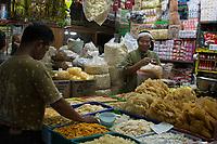 Yogyakarta, Java, Indonesia.  Man Selling Cashews, Nuts, and Other Snacks, Beringharjo Market.