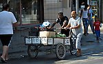 Men push a cart along a street in Suto Orizari, Macedonia. The mostly Roma community, located just outside Skopje, is Europe's largest Roma settlement. .