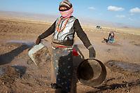 A Tibetan woman in traditional dress on the Qinghai-Tibetan Plateau. China.