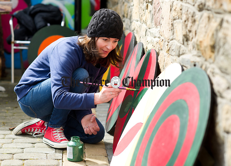 Local volunteer Donna Collins working on some colourful shields ahead of the forthcoming Brian Boru Millennium celebrations in Killaloe this weekend. Photograph by John Kelly.