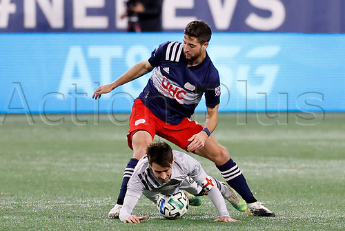 20th November 2020; Foxborough, MA, USA;  New England Revolution defender  Matt Polster fouls Montreal Impact midfielder Bojan during the MLS Cup Play-In game between the New England Revolution and the Montreal Impact