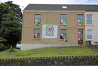 Pictured: A house draped in welsh flags in the Killay area of Swansea Wednesday 06 July 2016<br /> Re: Empty street in central Swansea, during rush hour, before the UEFA Euro 2016 Portugal v Wales semi-final