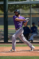 Colorado Rockies first baseman Jacob Bosiokovic (21) follows through on his swing during an Extended Spring Training game against the Chicago Cubs at Sloan Park on April 17, 2018 in Mesa, Arizona. (Zachary Lucy/Four Seam Images)