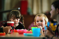 Pictured: Young children eat hot food at St Teilo Church in Clase, Swansea, UK. Friday 25 August 2017<br /> Re: Free food for children story, Swansea, Wales, UK.