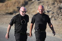 Pictured L-R: Detective Inspector Jon Cousins of South Yorkshire Police with forensic archaeologist Dr Karl Harrison arrive at the new search site in Kos, Greece. Friday 07 October 2016<br /> Re: Police teams led by South Yorkshire Police, searching for missing toddler Ben Needham on the Greek island of Kos have moved to a new area in the field they are searching.<br /> Ben, from Sheffield, was 21 months old when he disappeared on 24 July 1991 during a family holiday.<br /> Digging has begun at a new site after a fresh line of inquiry suggested he could have been crushed by a digger.