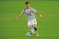 WASHINGTON, DC - NOVEMBER 8: Amar Sejdic #14 of Montreal Impact moves the ball during a game between Montreal Impact and D.C. United at Audi Field on November 8, 2020 in Washington, DC.