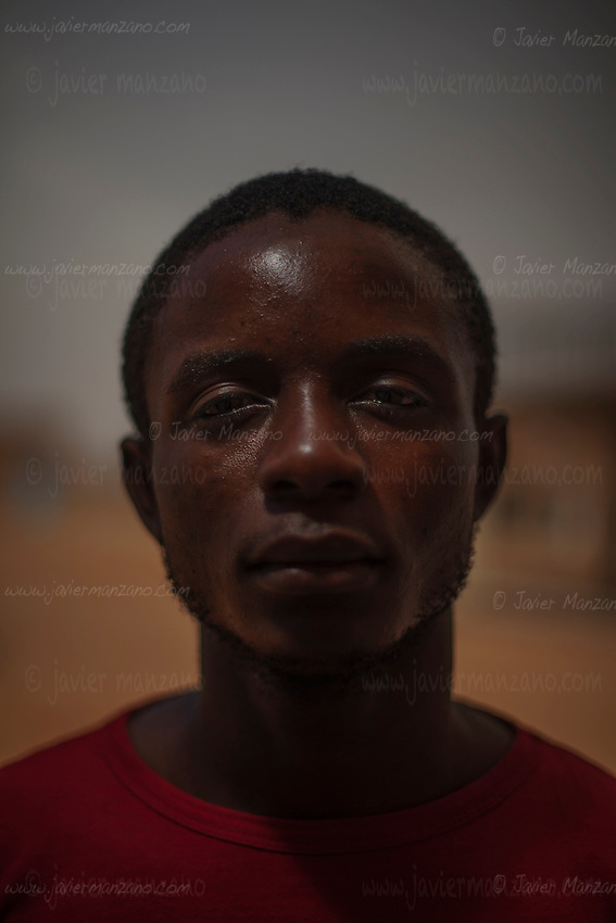 AGADEZ, NIGER — <br /> 22-year-old Ngole Briekz was a primary school teacher in Cameroon. He says he didn't earn enough money to make a living so decided, with the support of his family, to try his luck at attempting to reach Italy. The convoy he was riding in through the Sahara desert ran into a police check-point outside the city of Arlit in north Niger. He and 8 other migrants from Cameroon were  robbed of all their money by the police. He is now hoping to find someone to help him return to Cameroon.