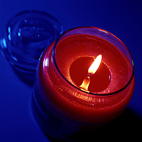 Candle jar on blue
