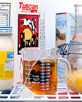 TEA COOLING IN REFRIGERATOR<br /> Tea Is In A Measuring Beaker With A Thermometer.