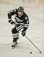 29 December 2014: Providence College Friar Defenseman John Gilmour, a Junior from Montreal, Quebec, in third period action against the University of Vermont Catamounts during the deciding game of the annual TD Bank-Sheraton Catamount Cup Tournament at Gutterson Fieldhouse in Burlington, Vermont. The Friars shut out the Catamounts 3-0 to win the 2014 Cup. Mandatory Credit: Ed Wolfstein Photo *** RAW (NEF) Image File Available ***