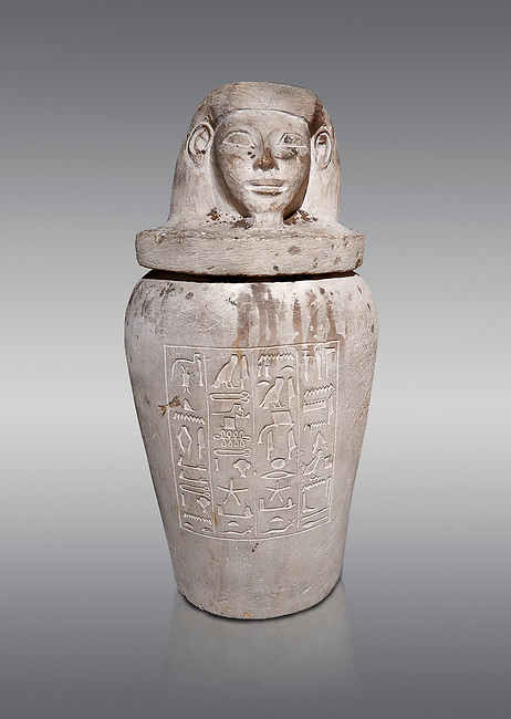 Ancient Egyptian Imesty or Amset Canopic Jar,  New Kingdom,  Egyptian Museum, Turin. Grey background.<br /> <br /> The canopic jars were four in number, each for the safekeeping of particular human organs: the stomach, intestines, lungs, and liver, all of which, it was believed, would be needed in the afterlife. Imsety, the human-headed god representing the South, whose jar contained the liver and was protected by the goddess Isis.