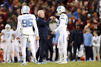 BLACKSBURG, VA - OCTOBER 19: Head coach Mack Brown of the University of North Carolina fist bumps place kicker Noah Ruggles #97 before a field goal attempt in the first overtime during a game between North Carolina and Virginia Tech at Lane Stadium on October 19, 2019 in Blacksburg, Virginia.