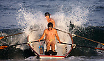 """Jack Green and Paul 'Bug"""" Elyssev of Asbury Park blast through a wave as they row in the 3,000-meter surfboat event at the First Annual Asbury Park Beach Bar Lifeguard Competition held at the 3rd Avenue beach in Asbury Park.  Green and Elyseev placed second in this event. ASBURY PARK, NJ  8/4/07  8:21:47 PM  PHOTO BY ANDREW MILLS"""