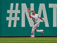 15 September 2013: Philadelphia Phillies outfielder Roger Bernadina pulls in a Ryan Zimmerman fly ball in the first inning of action against the Washington Nationals at Nationals Park in Washington, DC. The Nationals took the rubber match of their 3-game series 11-2 to keep Washington's wildcard hopes alive. Mandatory Credit: Ed Wolfstein Photo *** RAW (NEF) Image File Available ***