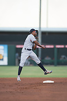 AZL Indians 2 second baseman Makesiondon Kelkboom (26) throws to first base during an Arizona League game against the AZL Angels at Tempe Diablo Stadium on June 30, 2018 in Tempe, Arizona. The AZL Indians 2 defeated the AZL Angels by a score of 13-8. (Zachary Lucy/Four Seam Images)