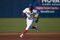 Bryan Ramos (10) of the Kannapolis Cannon Ballers hustles towards third base against the Columbia Fireflies at Atrium Health Ballpark on May 21, 2021 in Kannapolis, North Carolina. (Brian Westerholt/Four Seam Images)