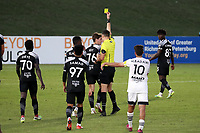 RICHMOND, VA - SEPTEMBER 30: Referee Matt Franz shows the yellow card to Kenny Hot #76 of New York Red Bulls II during a game between North Carolina FC and New York Red Bulls II at City Stadium on September 30, 2020 in Richmond, Virginia.