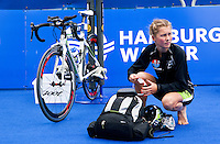 17 JUL 2011 - HAMBURG, GER - Rachel Klamer (NED) prepares in transition for the start of the women's Hamburg round of triathlon's ITU World Championship Series (PHOTO (C) NIGEL FARROW)
