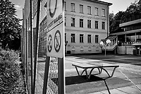"Switzerland. Canton Ticino. Lugano. Police line. The schools are closed. Nobody can enter the courtyard  Due to the spread of the coronavirus (also called Covid-19), the Federal Council has categorised the situation in the country as ""extraordinary"". It has issued a recommendation to all citizens to stay at home, especially the sick and the elderly. From March 16 the government ramped up its response to the widening pandemic, ordering the closure of bars, restaurants, sports facilities and cultural spaces. Only businesses providing essential goods to the population – such as grocery stores, bakeries and pharmacies – are to remain open. 29.04.2020 © 2020 Didier Ruef"