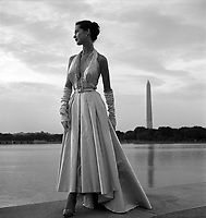 1949 - Fashion model posing in an evening gown on the steps of the Jefferson Memorial, Washington, District of Columbia, with Tidal Basin and Washington Monument in the background. Photograph by Toni Frissell