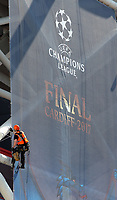 Pictured: Workers in abseiling gear install a banner outside the National Stadium of Wales (aka Principality Stadium) Thursday 25 May 2017<br /> Re: Preparations for the UEFA Champions League final, between Real Madrid and Juventus in Cardiff, Wales, UK.