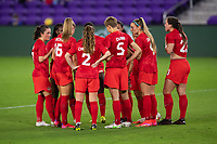 ORLANDO CITY, FL - FEBRUARY 18: Canada huddle during a game between Canada and USWNT at Exploria stadium on February 18, 2021 in Orlando City, Florida.