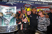 Sep 4, 2017; Clermont, IN, USA; NHRA top fuel driver Steve Torrence (left) celebrates with Antron Brown (center) and mother Kay Torrence after winning the US Nationals at Lucas Oil Raceway. Mandatory Credit: Mark J. Rebilas-USA TODAY Sports