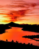 Lake Billy Chinook reflects the vivid colors at sunset below Mt. Jefferson