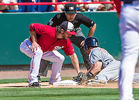 16 March 2014: Washington Nationals third baseman Will Rhymes is unable to get a sliding Stephen Lombardozzi out at third during a Spring Training Game against the Detroit Tigers at Space Coast Stadium in Viera, Florida. The Tigers edged out the Nationals 2-1 in Grapefruit League play. Mandatory Credit: Ed Wolfstein Photo *** RAW (NEF) Image File Available ***