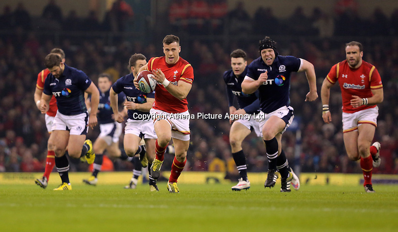 Gareth Davies of Wales (C) on his final run, before scoring the first try for his team during the RBS 6 Nations Championship rugby game between Wales and Scotland at the Principality Stadium, Cardiff, Wales, UK Saturday 13 February 2016