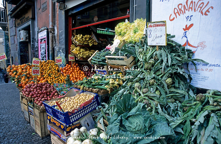 Fruit and vegetables on display outside a shop on the Piazza Del Gesu Nuovo, Naples, Italy.