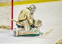 29 December 2013:  University of Vermont Catamount Goaltender Mike Santaguida, a Freshman from Mississauga, Ontario, makes a third period save against the Canisius College Golden Griffins at Gutterson Fieldhouse in Burlington, Vermont. The Catamounts defeated the Golden Griffins 6-2 to capture the 2013 Sheraton/TD Bank Catamount Cup NCAA Hockey Tournament for the second straight year. Mandatory Credit: Ed Wolfstein Photo *** RAW (NEF) Image File Available ***