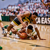 16 March 2019: University of Vermont Catamount Guard Ben Shungu, a Redshirt Sophomore from Burlington, VT, maintains possession of the rock in the first half against the UMBC Retrievers in the America East Championship Game at Patrick Gymnasium in Burlington, Vermont. The Catamounts defeated the Retrievers 66-49, avenging their loss against the same team in last years' Championship Game. Mandatory Credit: Ed Wolfstein Photo *** RAW (NEF) Image File Available ***