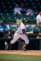 Bradenton Marauders shortstop Alfredo Reyes (13) follows through on a swing during a game against the Charlotte Stone Crabs on April 9, 2017 at LECOM Park in Bradenton, Florida.  Bradenton defeated Charlotte 5-0.  (Mike Janes/Four Seam Images)