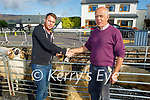 At the Castlemaine Fair in memory of the late John O'Donoghue and as a fundraiser for the Kerry Hospice on Sunday after striking a deal on the sale of a ram l to r: Maurice O'Donnell (Camp) and Michael Farrell (Keel).