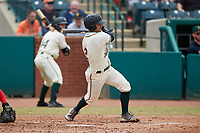 Nick Gonzales (2) of the Greensboro Grasshoppers follows through on his swing against the Rome Braves at First National Bank Field on May 16, 2021 in Greensboro, North Carolina. (Brian Westerholt/Four Seam Images)