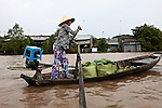 Scores of women come from miles around to sell their produce at the Cai Rang floating market, in the Mekong Delta, south of Can Tho, Vietnam. Sept. 30, 2011.