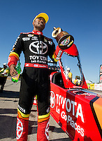 Sep 29, 2013; Madison, IL, USA; NHRA top fuel dragster driver Antron Brown celebrates after winning the Midwest Nationals at Gateway Motorsports Park. Mandatory Credit: Mark J. Rebilas-