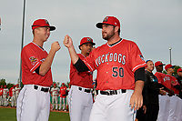Batavia Muckdogs Bryce Howe (50) fist bumps Kobie Taylor (left) during introductions before a NY-Penn League game against the Auburn Doubledays on June 14, 2019 at Dwyer Stadium in Batavia, New York.  Batavia defeated 2-0.  (Mike Janes/Four Seam Images)