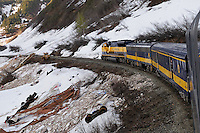 The Alaska Railroad's Coastal Classic train runs past the debris from an accident cased by an avalanche.