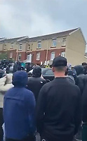 """Pictured: A large crowd of people gather in Waun-Wen Road in the Mayhill area of Swansea, Wales, UK. Thursday 20 May 2021<br /> Re: Gangs of """"yobs"""" have been setting fire to cars and rolling them down a hill in Swansea, Wales, UK.<br /> South Wales Police said they attended """"large scale disorder"""" in the Mayhill area of the city on Thursday evening."""