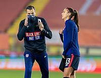 BREDA, NETHERLANDS - NOVEMBER 27: Vlatko Andonovski talks to Alex Morgan #13 of the USWNT during a game between Netherlands and USWNT at Rat Verlegh Stadion on November 27, 2020 in Breda, Netherlands.