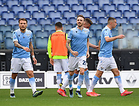 Football, Serie A: S.S. Lazio - Spezia, Olympic stadium, Rome, April 3, 2021. <br /> Lazio's Manuel Lazzari (c) celebrates after scoring with his teammates during the Italian Serie A football match between S.S. Lazio and Spezia at Rome's Olympic stadium, Rome, on April 3, 2021.  <br /> UPDATE IMAGES PRESS/Isabella Bonotto