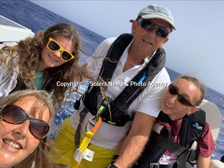 Pictured:  Natasha Lambert (right) with her mum Amanda, Dad Gary and sister Rachel.<br /> <br /> A young woman with cerebral palsy has sailed 3,000 miles across the Atlantic ocean in just 18 days - using only her mouth and tongue to control the boat.<br /> <br /> Natasha Lambert, 23, used the 'sip and puff' system engineered by her electrician father to sail from Gran Canaria on the Western coast of Africa to St Lucia in the Caribbean.<br /> <br /> The trip, which hoped to raise £30,000 for three charities, took 18 days, 24 hours, 29 minutes and eight seconds to complete.   SEE OUR COPY FOR DETAILS.<br /> <br /> © Solent News & Photo Agency<br /> UK +44 (0) 2380 458800