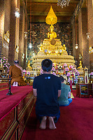 Bangkok, Thailand.  The Phra Ubosot (Ordination Hall) of the Wat Pho Temple Complex.  The Buddha holds the Dhyana mudra position, the gesture demonstrating meditation and wisdom.
