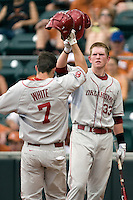 Firstbaseman Cameron Seitzer #33 of the Oklahoma Sooners greets teammate Max White #7 at home after a long home run against the Texas Longhorns in NCAA Big XII baseball on May 1, 2011 at Disch Falk Field in Austin, Texas. (Photo by Andrew Woolley / Four Seam Images)