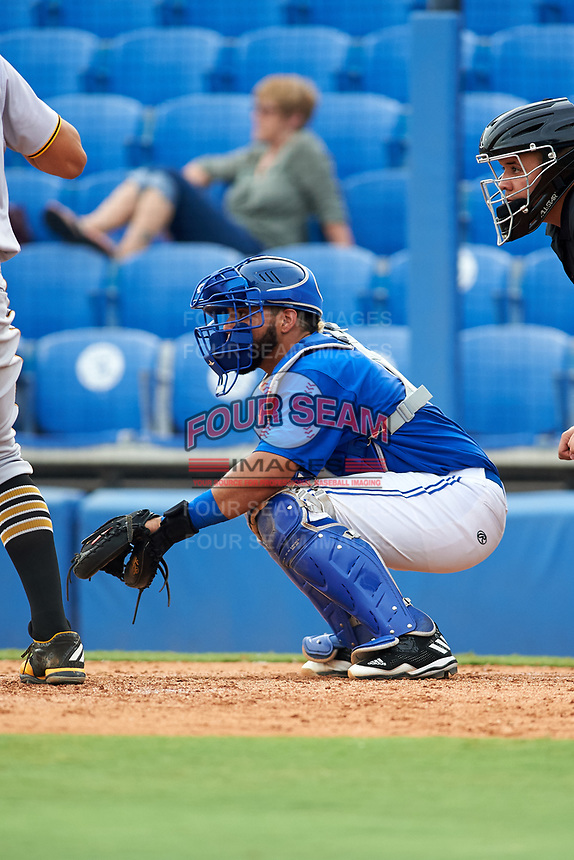 Dunedin Blue Jays catcher Michael De La Cruz (5) awaits the pitch in front of home plate umpire J.C. Velez during a game against the Bradenton Marauders on July 17, 2017 at Florida Auto Exchange Stadium in Dunedin, Florida.  Bradenton defeated Dunedin 7-5.  (Mike Janes/Four Seam Images)