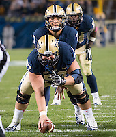 Pitt quarterback Tom Savage (7) gets ready for a snap from center Artie Rowell (57). The Pitt Panthers defeated the Old Dominion Monarchs 35-24 at Heinz Field, Pittsburgh, Pennsylvania on October 19, 2013.